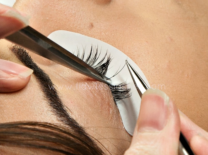 One eyelash extension is applied to one natural eyelash.